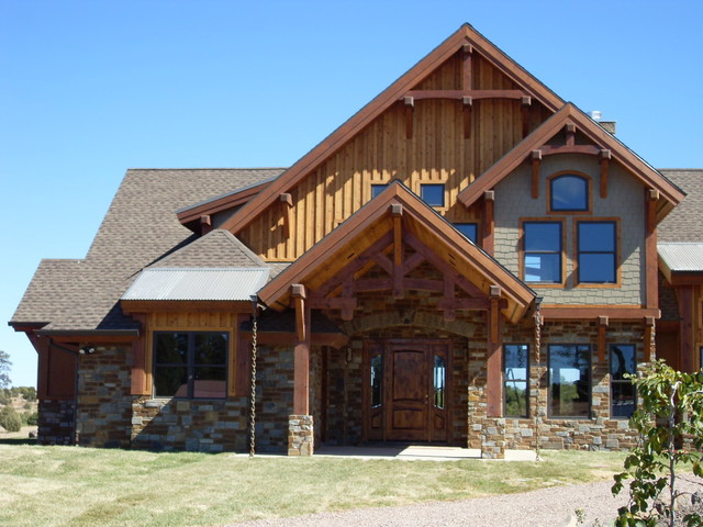 Large rustic multicolored two-story mixed siding house exterior idea in Phoenix with a hip roof and a shingle roof