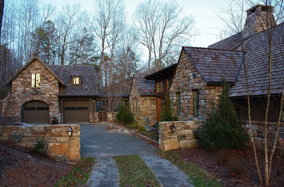 Large rustic multicolored one-story stone gable roof idea in Other