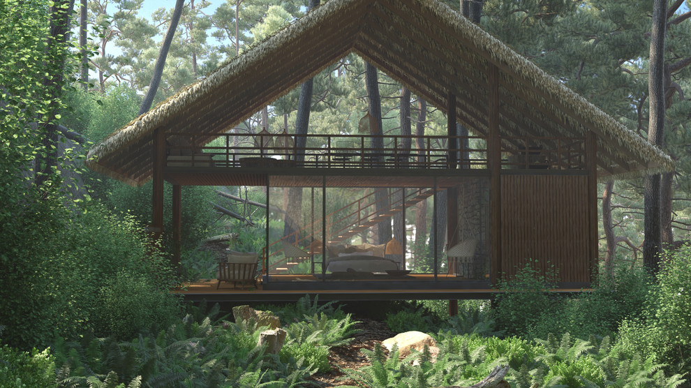 Small tropical brown two-story wood house exterior idea in Other with a shed roof and a green roof