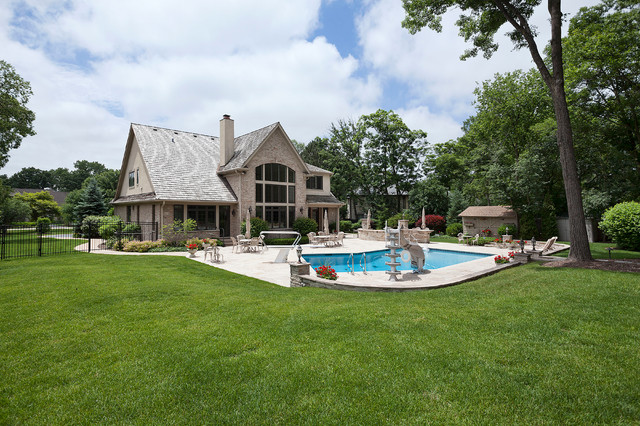 Inspiration for a timeless beige two-story brick exterior home remodel in Denver