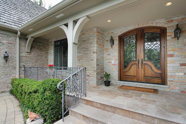 Elegant beige two-story brick exterior home photo in Denver