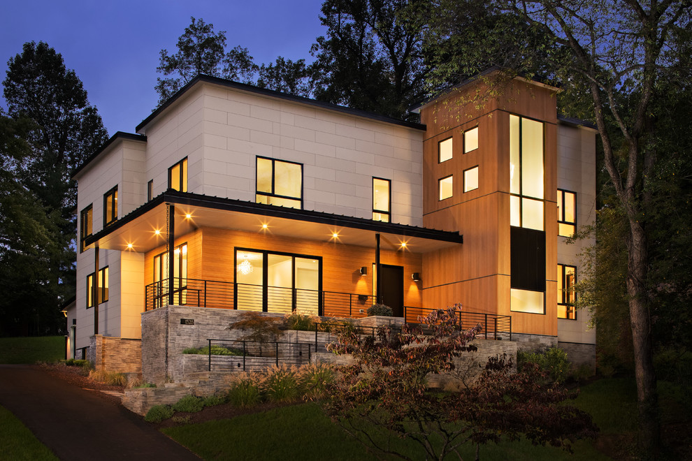 Inspiration for a large modern gray two-story mixed siding exterior home remodel in DC Metro with a mixed material roof
