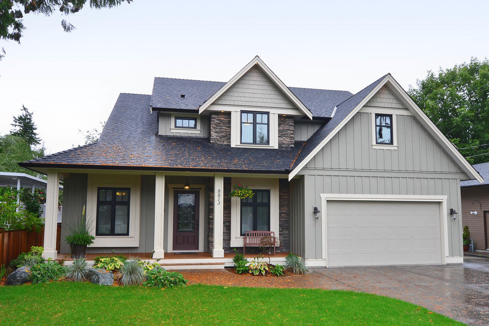 Inspiration for a timeless green three-story mixed siding gable roof remodel in Vancouver