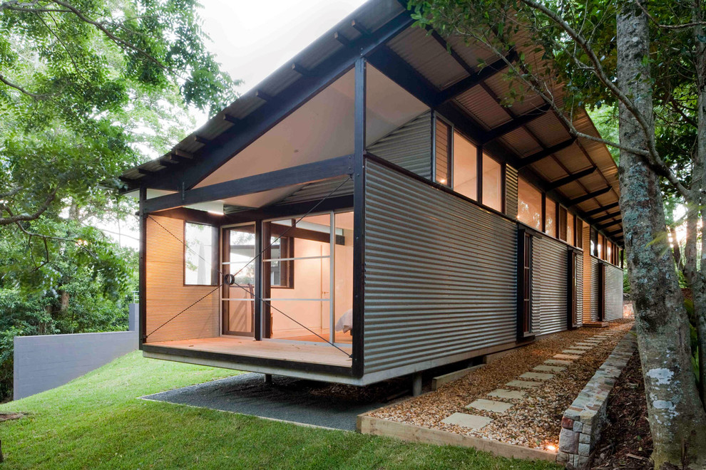 Example of a mid-sized urban one-story metal exterior home design in Sydney with a shed roof