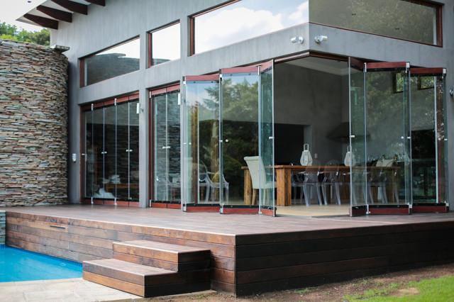Frameless Folding Doors Contemporary Exterior By Van Acht