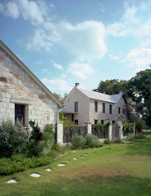 Fredericksburg stone house traditional exterior for Austin stone house plans