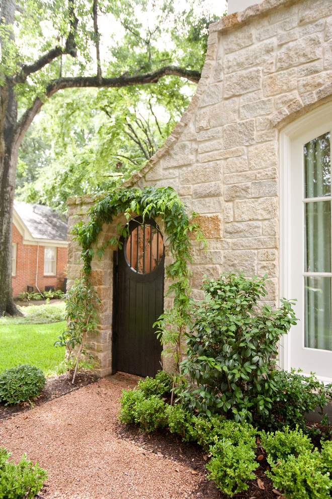 Traditional stone exterior home idea in Houston