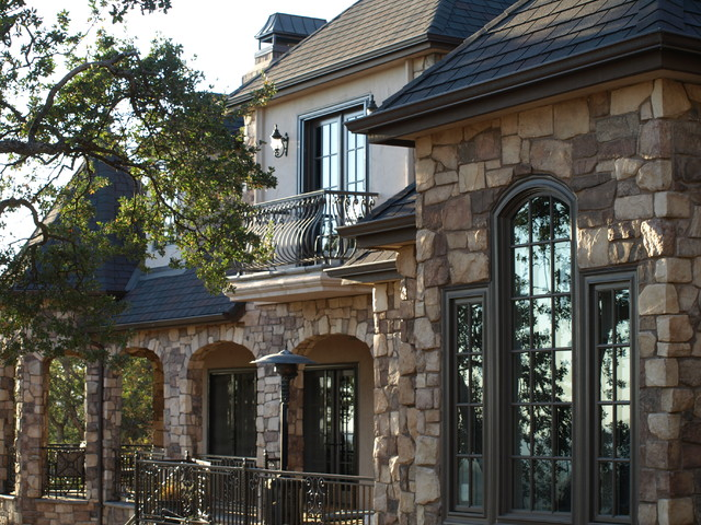 French Country Home With Stone Rear Exterior