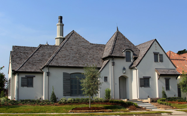 Inspiration for a mid-sized gray one-story stucco exterior home remodel in Dallas