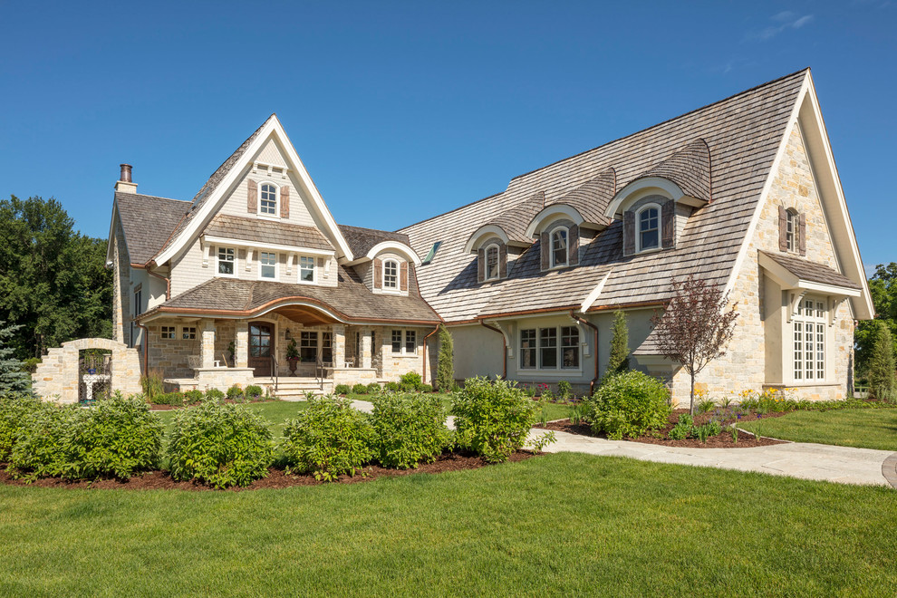 Traditional mixed siding house exterior idea in Minneapolis with a shingle roof
