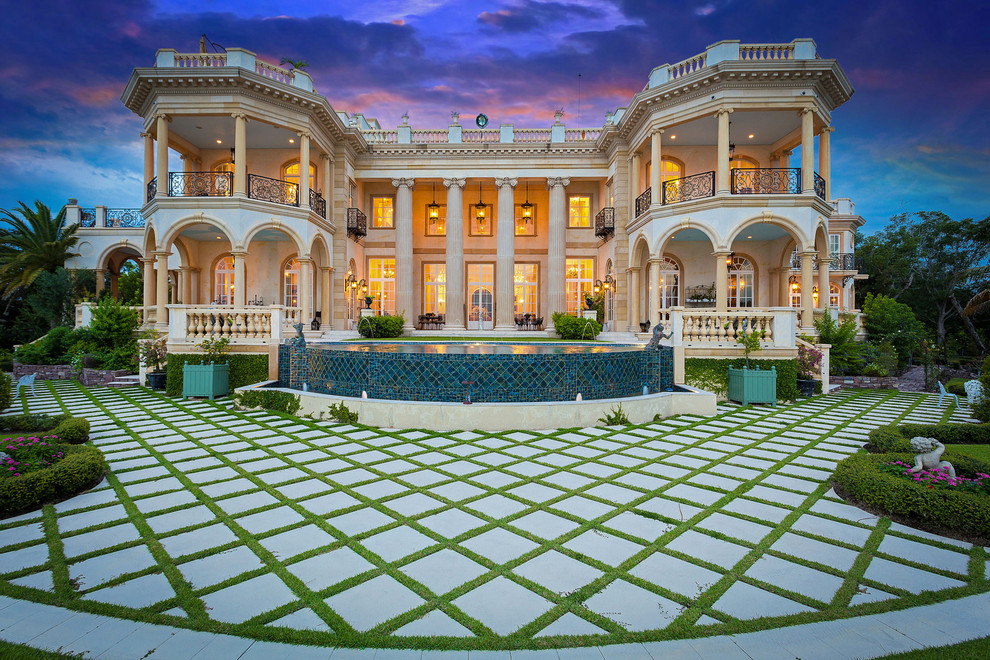 Huge tuscan beige three-story exterior home photo in Tampa