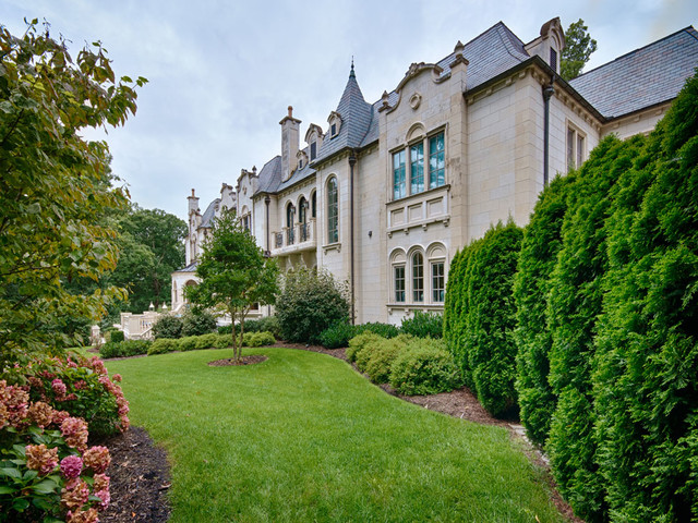 French style home in limestone mediterranean exterior for French chateau style homes for sale