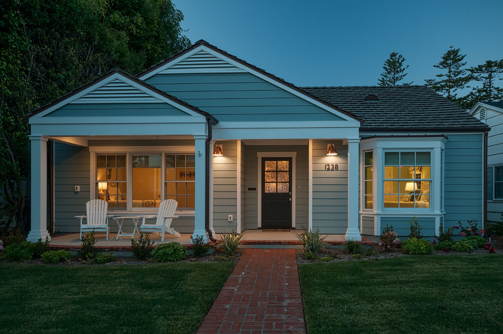 Example of a mid-sized coastal blue one-story wood exterior home design in San Diego