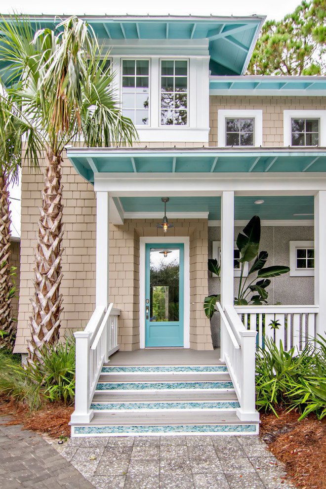 Inspiration for a beige and medium sized beach style two floor detached house in Jacksonville with wood cladding and a hip roof.