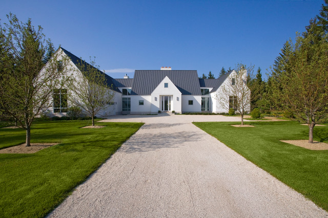Front Elevation of Contemporary European Farmhouse in White Stucco
