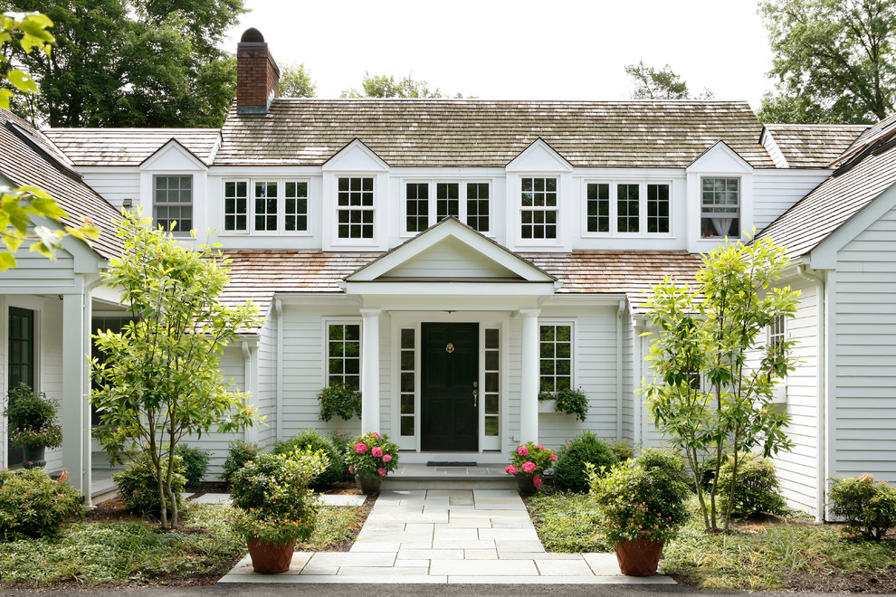 Inspiration for a huge timeless white two-story wood exterior home remodel in Other with a shingle roof
