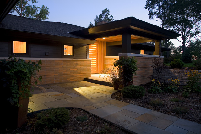 Inspiration for a large 1950s black one-story mixed siding exterior home remodel in Minneapolis with a hip roof