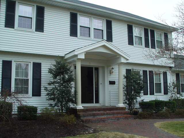 Front entry portico overhang other metro by design build pros - Houses overhang practical design ...