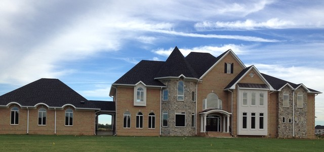 Front Exterior Full Brick House With Stone And Dryvit