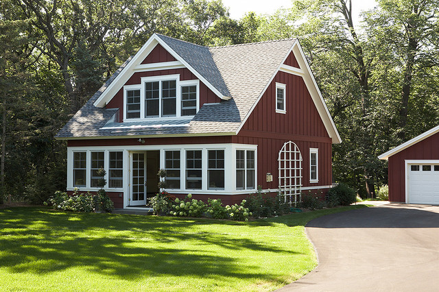 Front exterior of the little red sided cottage from the for Board and batten home designs