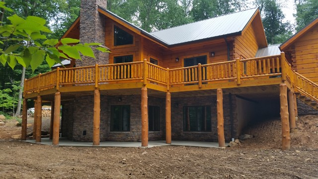 Front Exterior Stone Work And Heavy Timber Porch