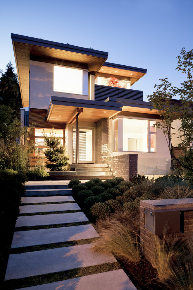 Example of a trendy two-story exterior home design in Vancouver