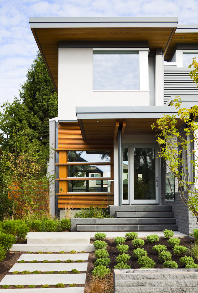 Trendy wood exterior home photo in Vancouver