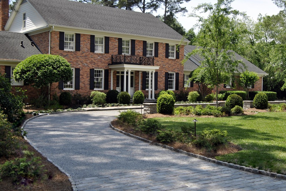 Large traditional red three-story brick gable roof idea in Atlanta with a shingle roof