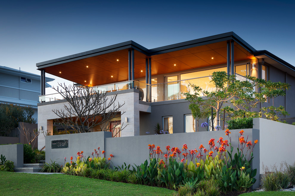 Large trendy gray two-story flat roof photo in Perth