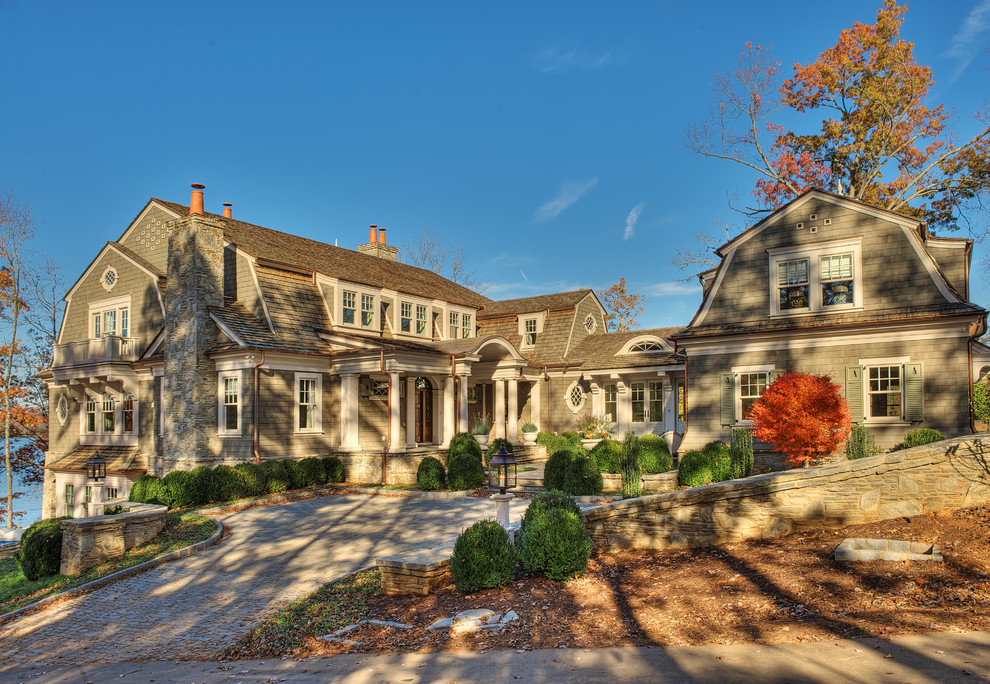Large elegant gray two-story wood house exterior photo in Other with a gambrel roof and a shingle roof