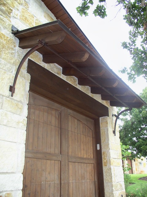 garage door shed roof and iron bracket support mediterranean