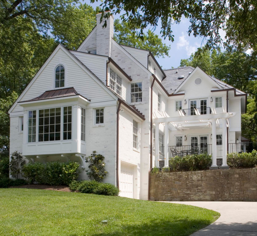 Huge elegant white three-story brick house exterior photo in DC Metro with a shingle roof