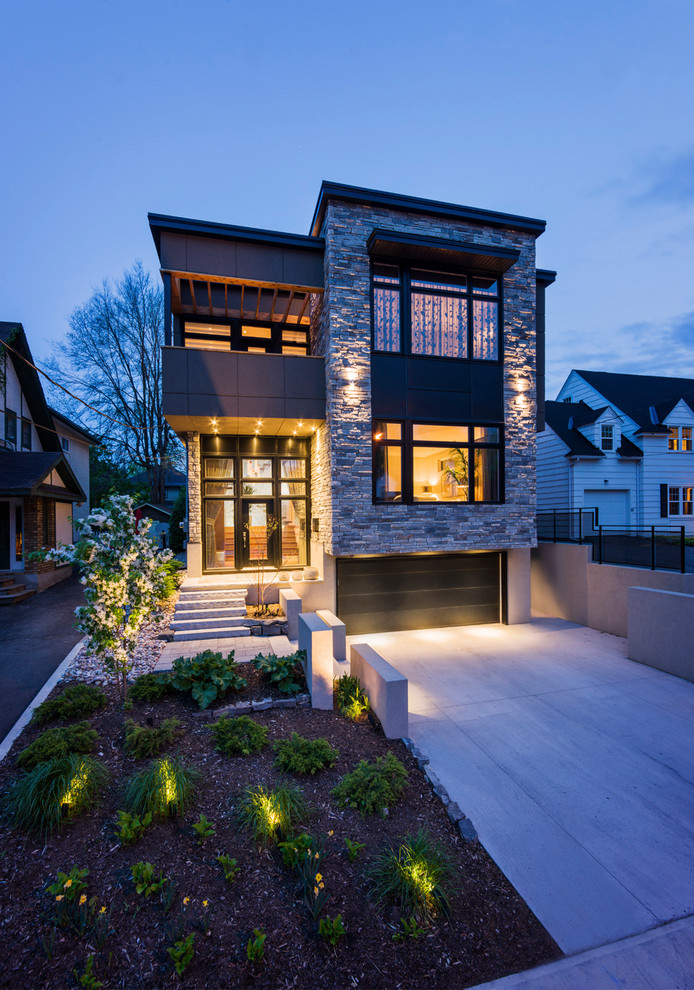 Inspiration for a contemporary two-story stone flat roof remodel in Ottawa