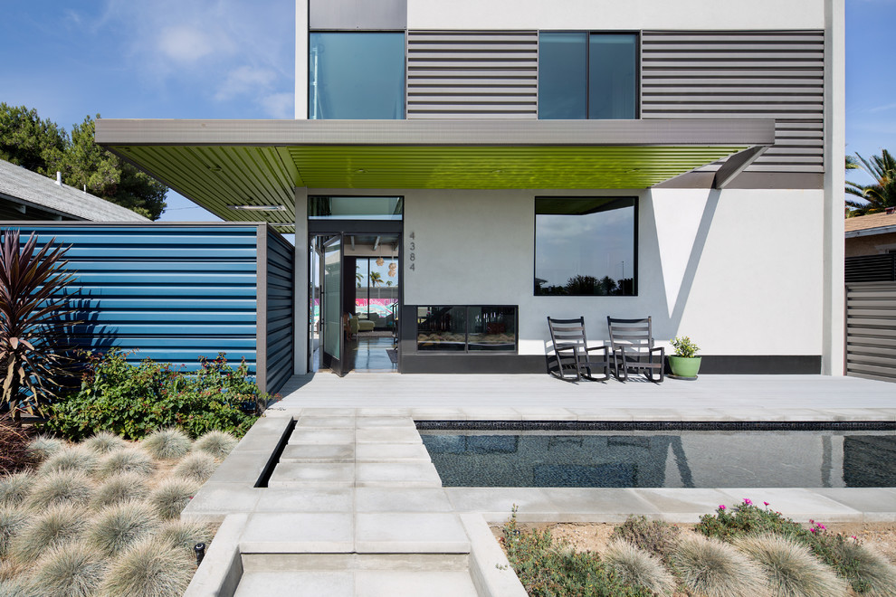 Inspiration for a large contemporary white two-story mixed siding flat roof remodel in San Diego