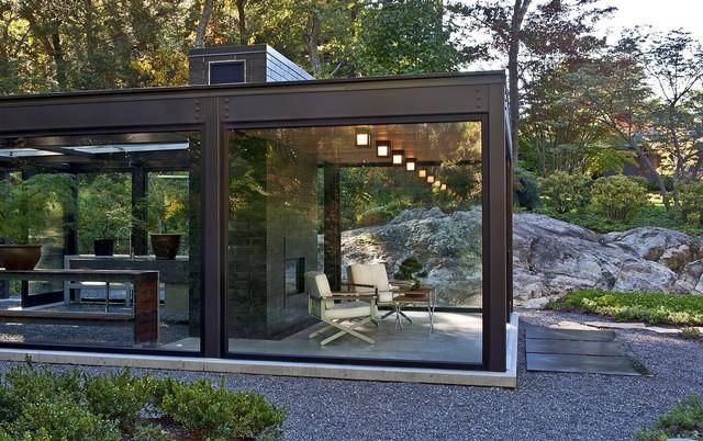 Glass house in the garden modern exterior