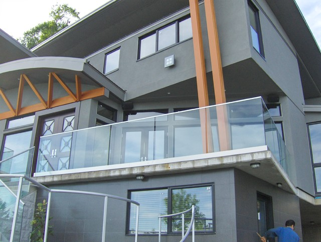 Glass garage door living room - Glass Railings Contemporary Exterior Vancouver By