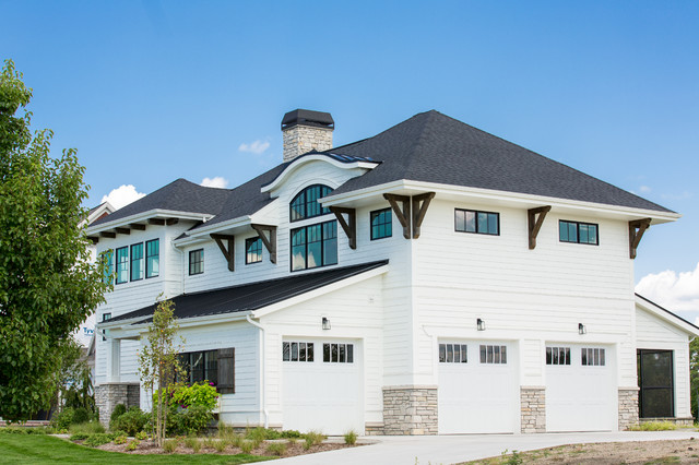 Example of a large transitional white two-story concrete fiberboard house exterior design in Other with a hip roof and a shingle roof