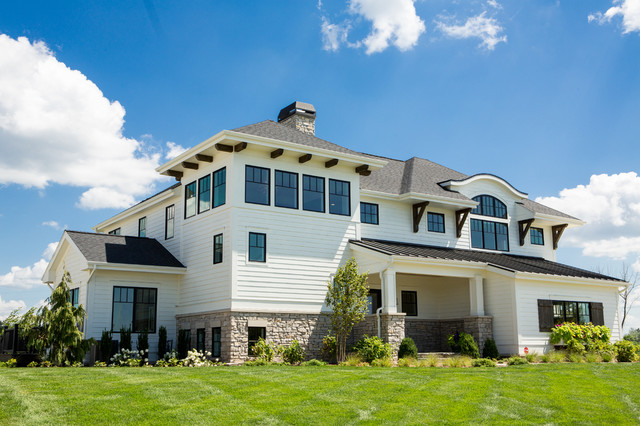 Large transitional white two-story concrete fiberboard house exterior photo in Other with a hip roof and a shingle roof
