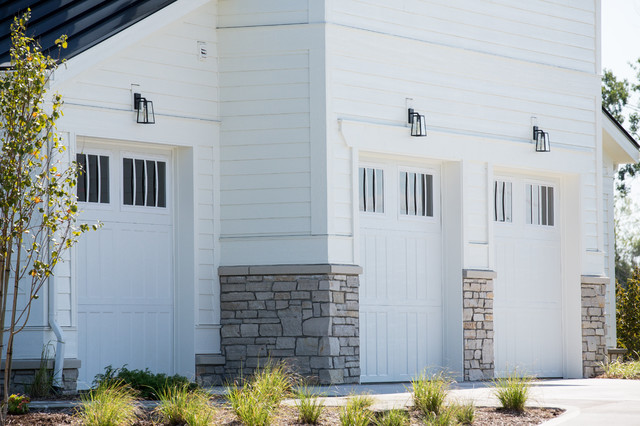 Large transitional white two-story concrete fiberboard house exterior idea in Other with a hip roof and a shingle roof