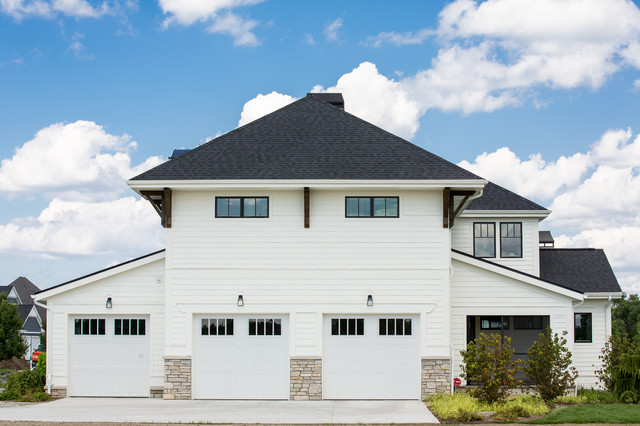 Inspiration for a large transitional white two-story concrete fiberboard house exterior remodel in Other with a hip roof and a shingle roof