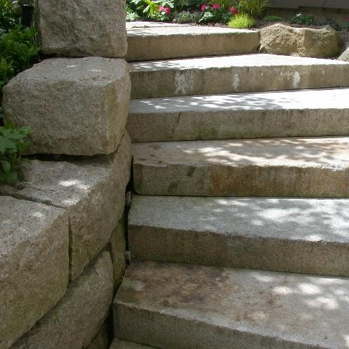 golden granite retaining wall with antique stair treads