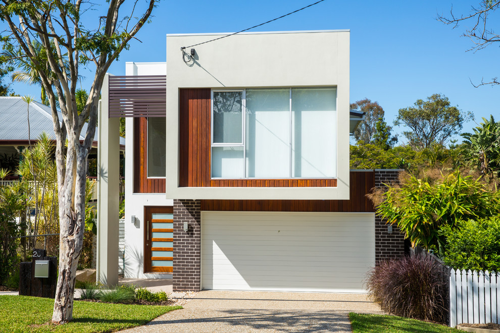 Trendy two-story flat roof photo in Brisbane