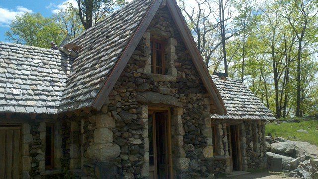 Granite Shingled Stone House eclectic-exterior
