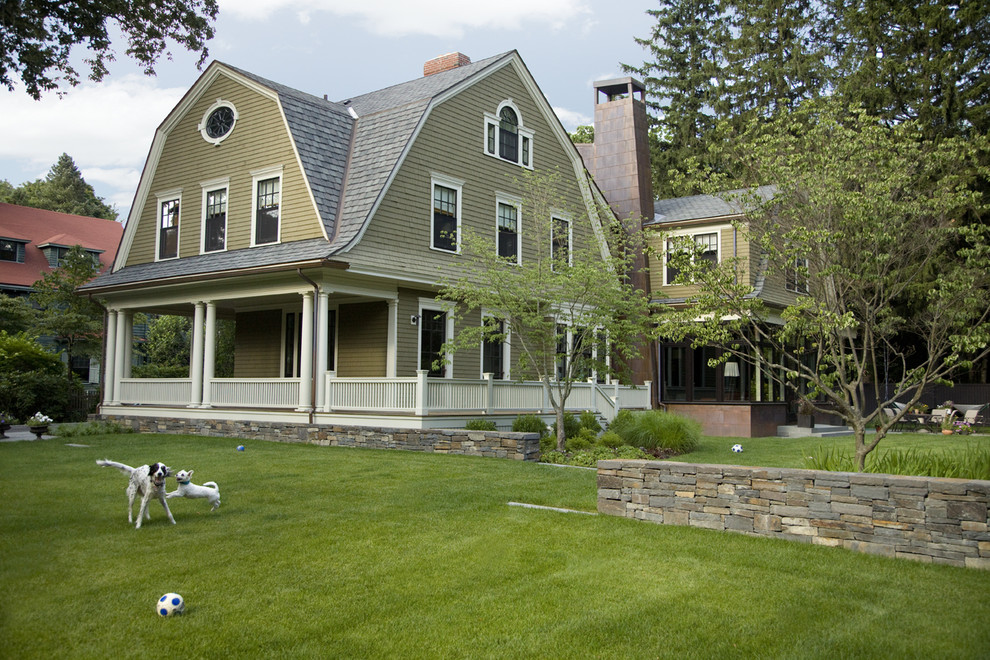 Inspiration for a large timeless three-story wood exterior home remodel in Boston with a gambrel roof