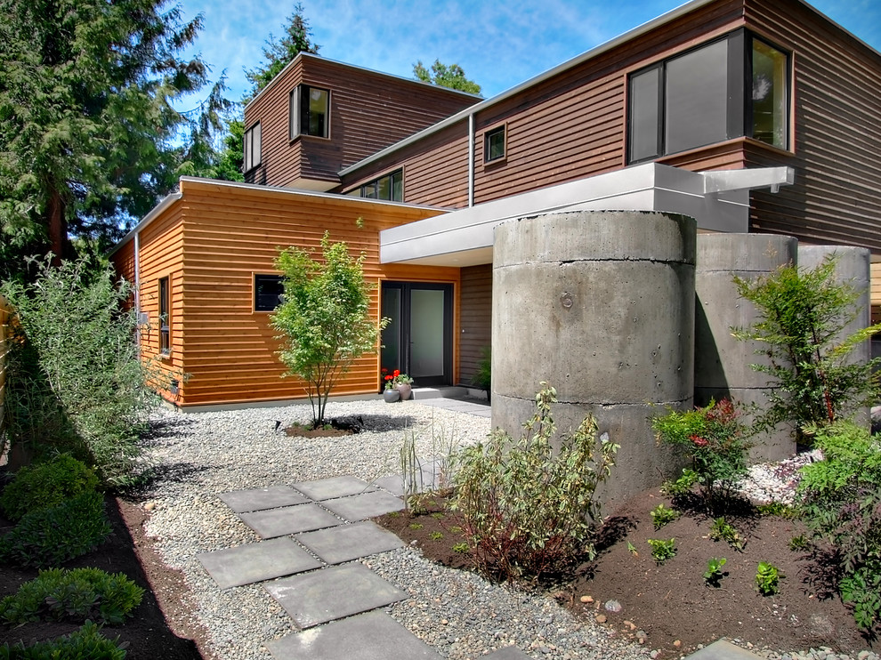 Inspiration for a large contemporary multicolored three-story wood exterior home remodel in Seattle