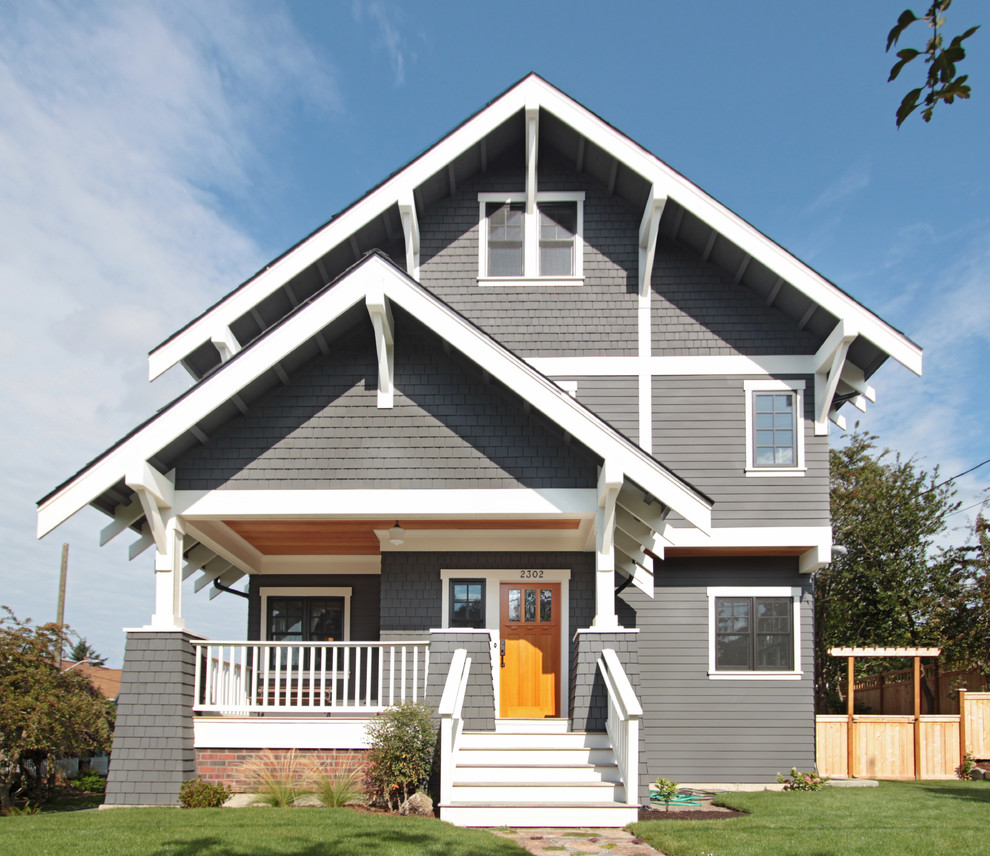 Example of a large arts and crafts gray three-story wood exterior home design in Seattle with a shingle roof