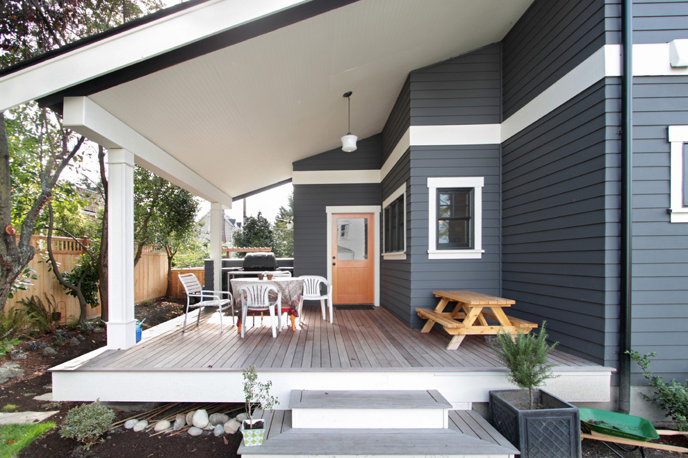 Inspiration for a mid-sized craftsman gray three-story wood exterior home remodel in Seattle with a shingle roof