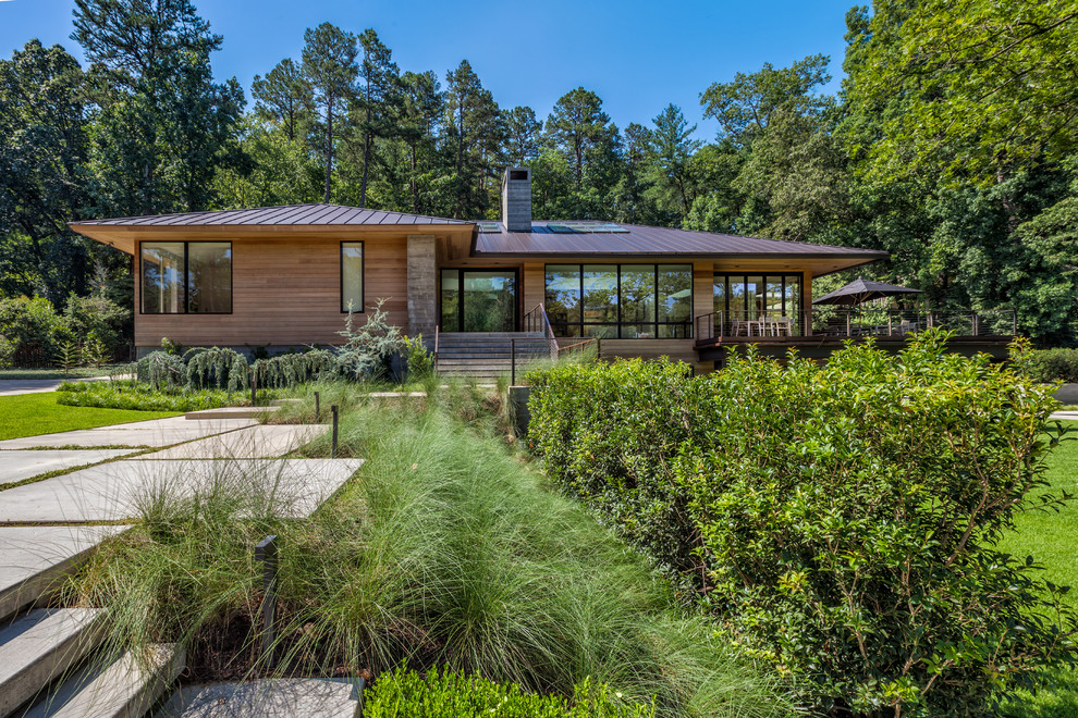 Inspiration for a large contemporary multicolored two-story mixed siding exterior home remodel in Charleston with a hip roof