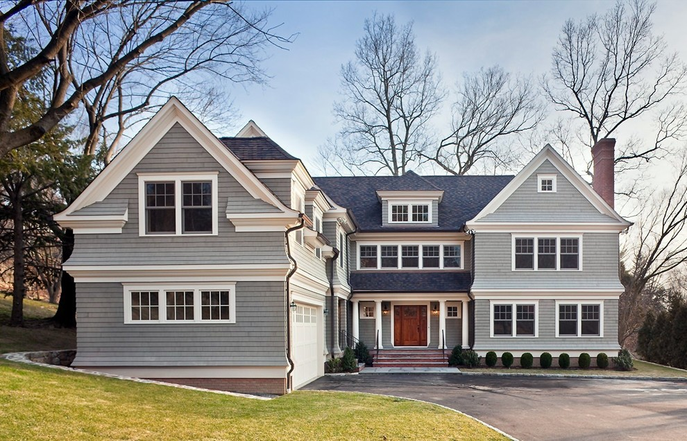 Inspiration for a mid-sized craftsman gray two-story wood exterior home remodel in New York with a shingle roof
