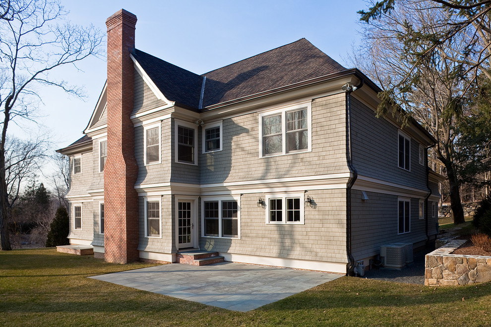 Mid-sized arts and crafts gray two-story wood exterior home photo in New York with a shingle roof